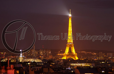 The Eiffel tower with the Elysee Palace. Note the lit flag signifying the president being in residence. Paris , France.