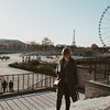 woman in paris with ferris wheel and eiffel tower in the background