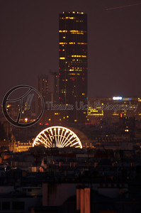 "There was a carnival in the Jarden de Tulleries. The tower Montparnasse is in the background. They had a shooting gallery with real rifles! You would shoot moving targets with a .22 rifle. I shot 24 in a row and people started to gather around. Someone asked me how I shot so well. To which I simply replied ""I am American"" to which they all nodded. Paris, France."
