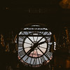 view of montmartre and Sacre Coeur  through clock window at Musee d'Orsay