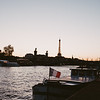 silhouette of the eiffel tower at sunset with the seine river in foreground