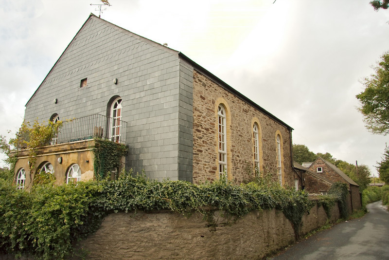 This is an old Methodist meeting house at the foot of the hill where the rivers join. It is now a private home. It is said that John Wesley preached here.