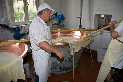 Cheese wheel being raised
