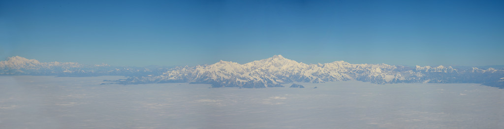 Panoramic view of the Himalayan range including the peaks of Mount Everest enroute flight from Paro, Bhutan to Mumbai, India on Druk Air flight.