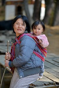 Bhutanese mother and child at the base of Taktsang Monastery (Tiger's Nest). Paro Taktsang  is the popular name of Taktsang Palphug Monastery.
