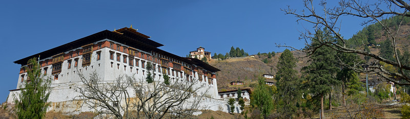 Panoramic image of Rinpung Dzong (Paro Dzong) a fortress-monastery overlooking the Paro valley which was first built on by Padma Sambhava at the beginning of the tenth century.  Rinpung Dzong is a large dzong - Buddhist monastery and fortress - of the Drukpa Lineage of the Kagyu school in Paro District in Bhutan. It houses the district Monastic Body and government administrative offices of Paro Dzongkhag.