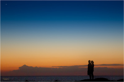 A silhouetted couple enjoy the vast Gulf of Mexico