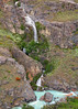 "24. Waterfall seen on first-day. The pale blue of the water is from glacial silt, called ""glacial milk."""