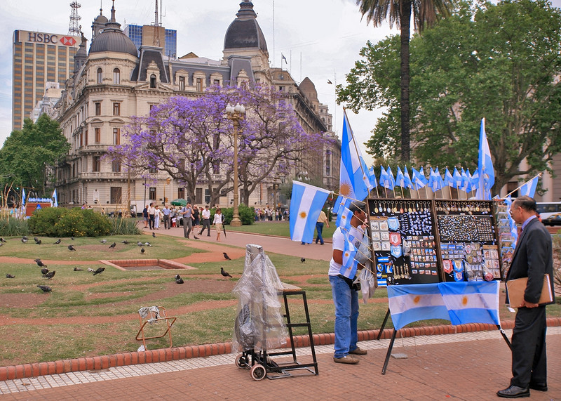 01. The trip begins with two days in Buenos Aires. Argentine flags for sale at Plaza de Mayo.
