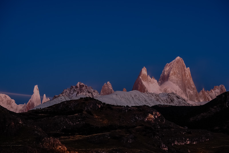 The Cerro Torre and Fitz Roy peaks dominate the El Chalten skyline at dawn