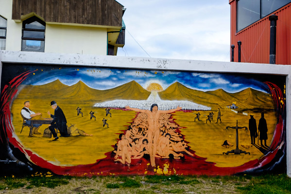 A mural at the museum about genocide of the native culture on Tierra del Fuego