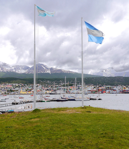 OAT Patagonia trip, Dec 2013.<br /> Ushuaia.  Argentina flag on the right.  Don't know what the other one is.