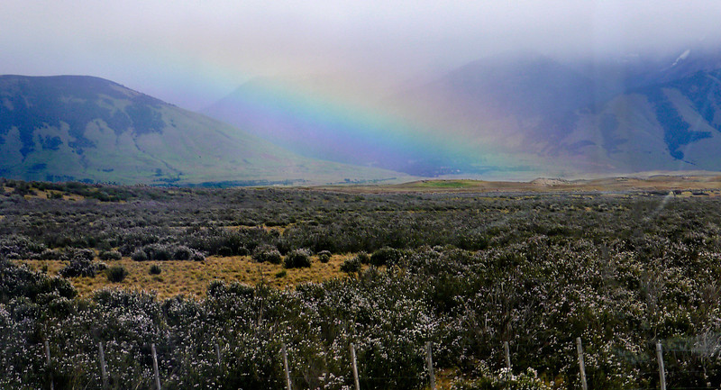 OAT Patagonia trip, Dec 2013.<br /> We take the scenic route, on an unpaved road, enroute from El Calafate to the Perito Moreno Glacier, Argentina. We see a rainbow from the bus.