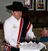"""OAT Patagonia trip, Dec 2013.<br /> This portion of the tour took place on the Via Australis boat.<br /> Patricio serves us a different Chilean wine, """"Carmenere"""", to taste."""