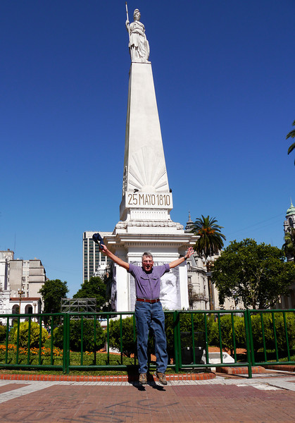 """OAT Patagonia trip, Dec 2013. The """"May Pyramid"""" located at the hub of the Plaza de Mayo, is the oldest national monument in the City of Buenos Aires. The May Revolution (Spanish: Revolución de Mayo) was a week-long series of events that took place from May 18 to 25, 1810, in Buenos Aires. The monument is crowned by an allegory of Liberty."""