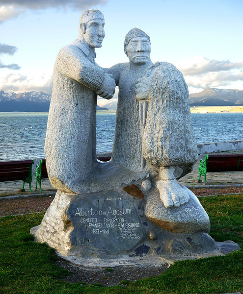 """OAT Patagonia trip, Dec 2013.<br /> Puerto Natales, Chile. This statue was just across the street from our hotel.<br /> Rough translation:<br /> """"Alberto de Agostini<br /> Scientist-Explorer<br /> Salesian Missionary<br /> 1883-1960<br /> Donated by the Margoni Altamirano family in 2011""""<br /> ADDL INFO:  Father Alberto Maria De Agostini (2 November 1883 – 25 December 1960) born in Pollone, Piedmont, was an Italian missionary of the Salesians of Don Bosco order as well as a passionate mountaineer, explorer, geographer, ethnographer, photographer, and cinematographer.<br /> De Agostini lived as a missionary in Tierra del Fuego and Patagonia, between Chile and Argentina, where he was the first person to reach several mountain peaks, glaciers and sea sounds; and discovered others, some named after him.<br /> In January–February 1931 he, Egidio Feruglio, and the alpine mountain guides Croux and Bron, were the first to fully cross the Southern Patagonian Ice Field; they did it from Lago Viedma (Argentina) to the vicinity of Patagonian channels of the Pacific Ocean (Chile), and back.<br /> He also sustained a long and deep relationship with the native people of Tierra de Fuego.<br /> In addition he left behind 22 books and written works in Italian, German and Spanish; a precious collection of several hundred photographies; and a documentary film; all of them on Patagonia and Tierra de Fuego and the Fuegian tribes.<br /> He died in Turin on Christmas Day, 1960.<br /> There is now an Alberto de Agostini National Park in the west part of Tierra del Fuego named after him."""