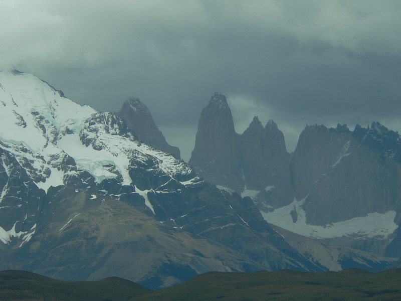 "These are the actual Torres del Paine (literally, ""Towers of Blue"") although ""paine"" is a Yamana word for light blue, and has more to do with the glacial lakes, as you'll see."