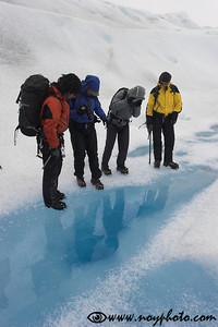 A guided hike on the Glaciar Grey in Torres del Paine National Park.  Here we are looking at the melthole in the ice, many meters deep.    A glacier is a surreal world which feels almost as a photographic negative: the soil is white, the rivers are deep blue, and when a mountain sticks out of the ice, it has a black top and white slopes...