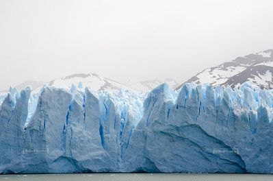 Up close and personal - the icy and incredibly blue face of the Perito Moreno Glacier seen from a boat, Glaciers National Park, Patagonia, Argentina
