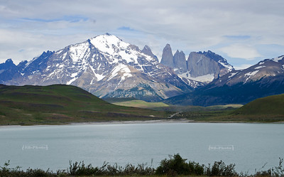 View over the Amarga Lagoon with the three famous granite towers of the Paine range far in the background. The name of the lagoon (amarga translates to bitter) was given due to high levels of sodium, chloride and nitrogen it contains.