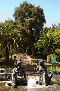 A fountain with sculptures of a man and a woman serves as traffic island near the Cerro Santa Lucia in Santiage, Chile
