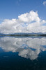 Majestic cloudscape and reflection over the unusually calm Beagle Channel, Tierra Del Fuego, Patagonia, Argentina