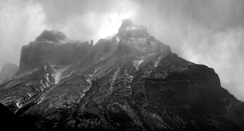 Cerro Paine Grande.  At this point the rain was pretty steady but somehow the wind gust opened up the mountain, so I was able to take a shot...  This was our first (and last) glimpse of this 3,050m peak on that day.