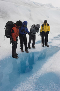 A melthole on the ice.   A glacier is this surreal alternative world where you feel as if you are inside a negative: the soil is white, the rivers aver deep blue, and if you have a tall mountain sticking out of the ice, it has a black cap...
