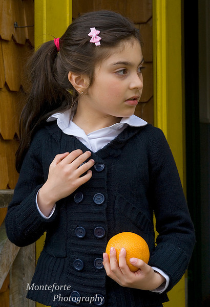 Chilean Girl with orange, Tortel Chile