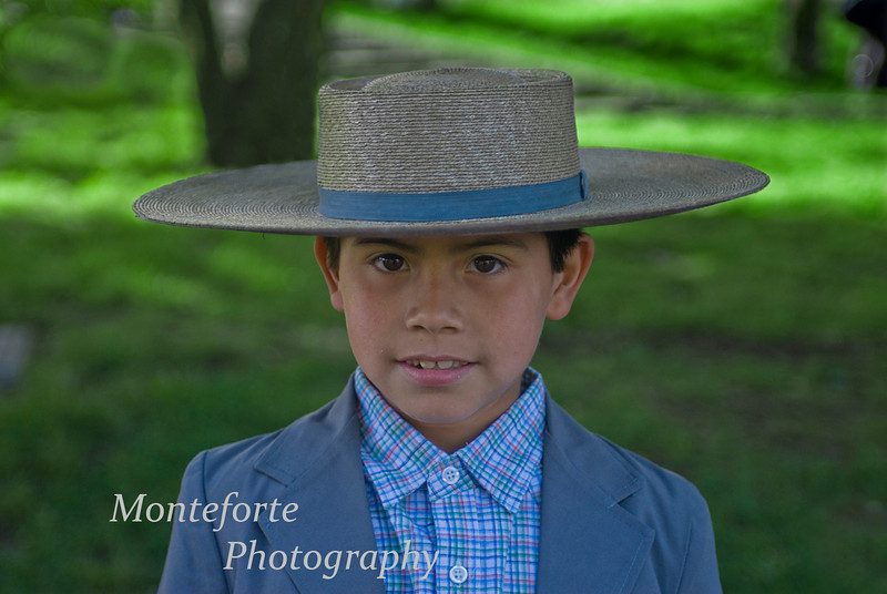 Boy in traditional dress at street fair in Coyhaique Chile.