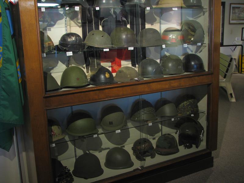 Varies helmets on display.