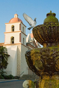 Santa Barbara Mission, Santa Barbara, CA.  I know the pigeon looks like I added it in there for some reason, but honestly, the thing came to get a drink of water just as I squeezed the shutter.  The flash scared him off, so it was really just a touch and go.