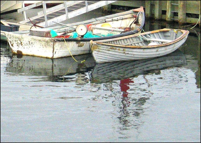 Rowboats and their reflections, Peggy's Cove, Nova Scotia