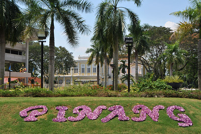 "Sri Pinang in grass. Penang (pronounced /pəˈnæŋ/; (Malay: Pulau Pinang)) is a state in Malaysia which is located on the north-west coast of Peninsular Malaysia by the Strait of Malacca. The name ""Penang"" comes from the modern Malay name Pulau Pinang, which means island of the betel nut tree. It is the second smallest state in Malaysia. Penang is often known as ""The Pearl of the Orient"" and ""Pulau Pinang Pulau Mutiara"" (Penang Island of Pearls)."