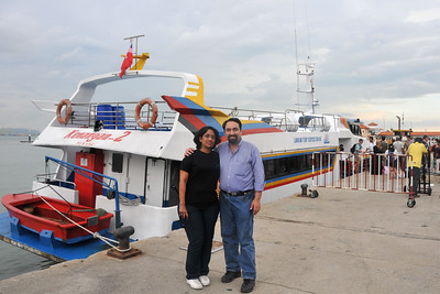 Anu & Suchit getting off the Langkawi Ferry service into Penang. Arriving in Penang by ferry from Langkawi, Malaysia