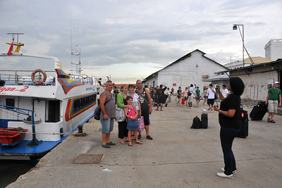 Anu taking a picture for a group when arriving in Penang by ferry from Langkawi, Malaysia