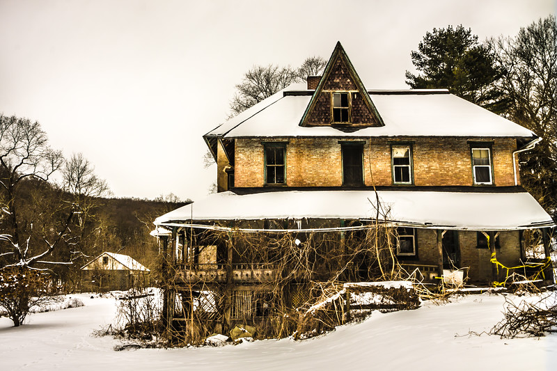 Abandoned and haunted looking farmhouse