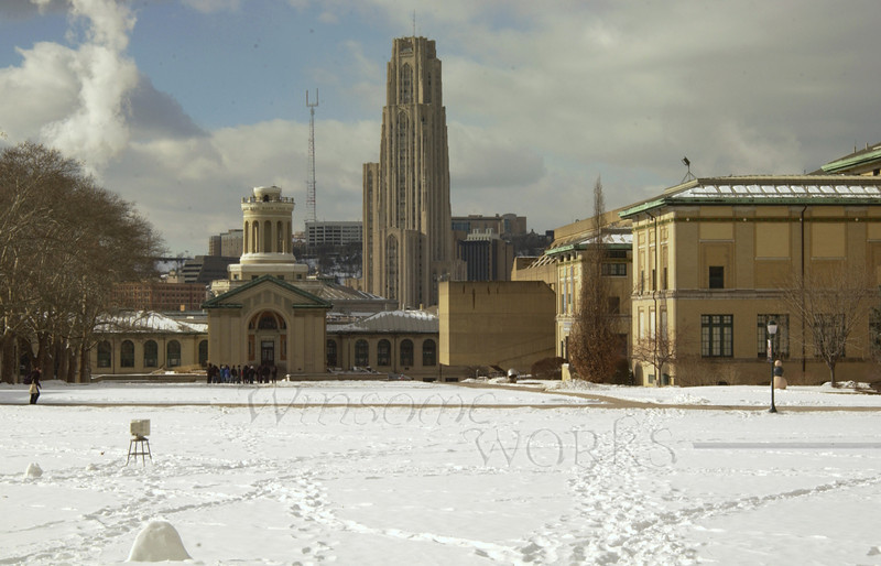 "Carnegie-Mellon's Ad building, with Pitt's ""Tower of Learning"" in the background"