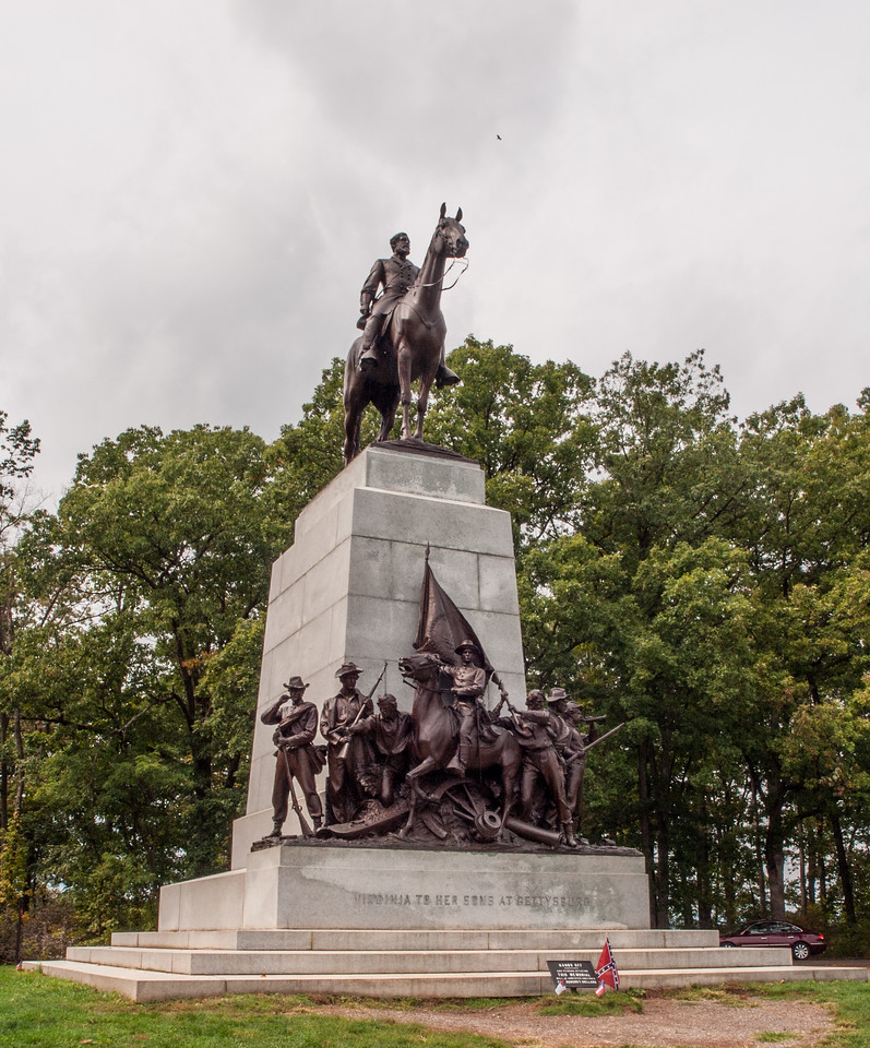 The State of Virginia monument is southwest of Gettysburg on West Confederate Avenue. It is also the largest of the Confederate monuments, a fitting tribute for the state that provided the largest contingent to the Army of Northern Virginia, its commander, and its name. Lee's figure, topping the monument astride his favorite horse, Traveller<br /> <br /> The group represents various types who left civil occupations to join the Confederate Army. Left to right; <br /> a professional man, a mechanic, an artist, a boy, a business man, a farmer, a youth