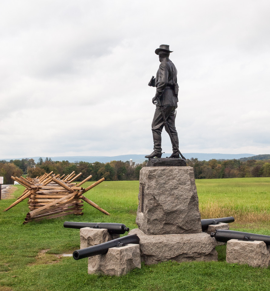The monument to Brigadier General John Buford is west of Gettysburg on Chambersburg Road (U.S. 30) at the intersection with Stone Avenue. (39.83795° N, 77.25164° W; see map) It was erected in 1892 and dedicated on July 1, 1895.<br /> <br /> The cannon surrounding the monument are the actual pieces of Calef's Battery, 2nd United States Artillery, Battery A. The barrel facing down Chambersburg Pike (the one facing toward the lower left corner of the photograph) fired the first Union artillery shot of the battle under General Buford's personal direction. Captain Calef tracked it down after the war using its serial number, 223. It is marked by a small bronze plate which can be seen in the photo on top of the barrel