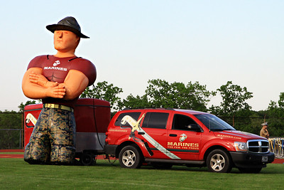 An inflatable marine watches over the field.