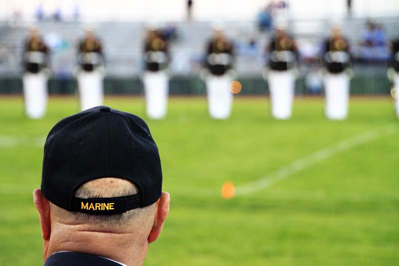 The silent drill team observed by a veteran.