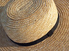 Close-up of Amish farming hat from Pennsylvania German area, made by stitching braided straw together