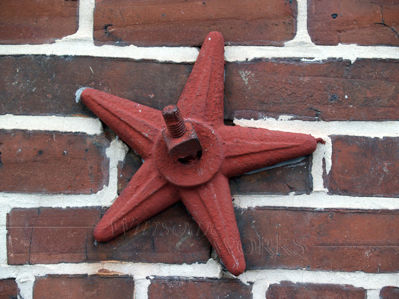 vintage star bolt or earthquake bolt... decorative and functional element used in Victorian and later eras for architectural stability