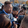 Larry Holmes gives an interview after the service