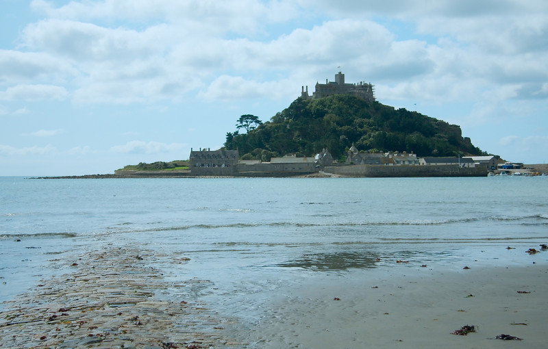 The partially submerged road to St. Michael's Mount as low tide approches