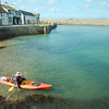 A kayaker about to leave the safety of the sea walls at St. Michael's Mount