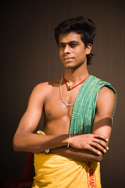 Handsome Young Hindu Priest<br /> Singapore Nov 2006<br /> © WEOttinger, The Wildflower Hunter - All rights reserved<br /> For educational use only - this image, or derivative works, can not be used, published, distributed or sold without written permission of the owner.