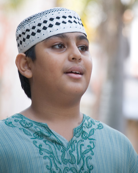 Young Muslin boy in green shirt.<br /> Singapore Nov 2006<br /> © WEOttinger, The Wildflower Hunter - All rights reserved<br /> For educational use only - this image, or derivative works, can not be used, published, distributed or sold without written permission of the owner.