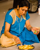 Indian Woman preparing offering at Hindu Temple<br /> Singapore Nov 2006<br /> © WEOttinger, The Wildflower Hunter - All rights reserved<br /> For educational use only - this image, or derivative works, can not be used, published, distributed or sold without written permission of the owner.